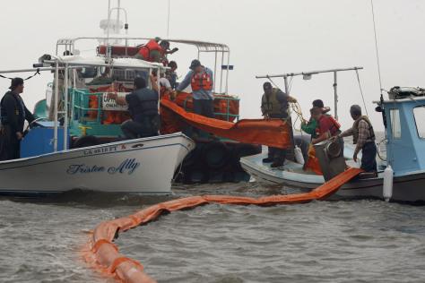 Image: Fisherman lay booms