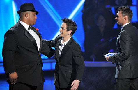 Image: Contestant Michael Lynche (L), eliminated contestant Aaron Kelly and host Ryan Seacrest onstage