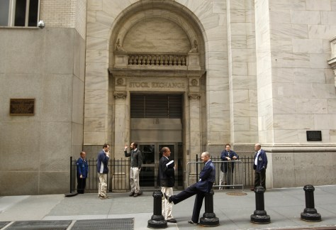 Image: Traders smoke cigarettes outside the New York Stock Exchange
