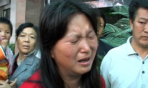 Image: A Chinese woman cries