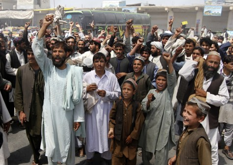 Image: Afghan protesters shout anti-American slogans during a protest rally in Kandahar