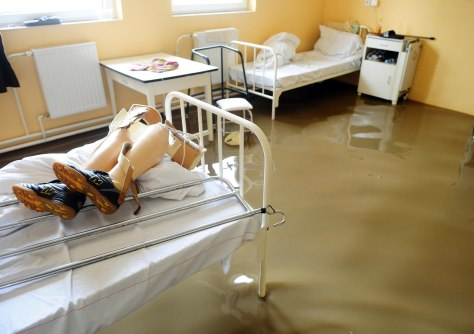 Image: Prosthetic legs lie on a bed in a hospital that was evacuated in Szikszo