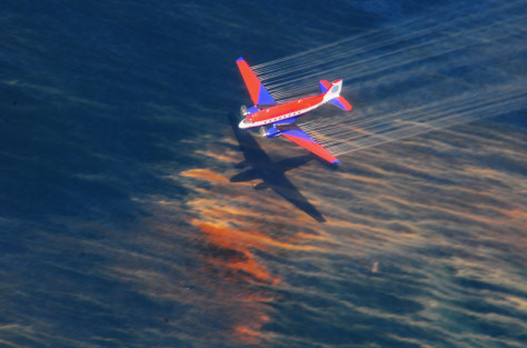 Image: Aircraft releases oil dispersant