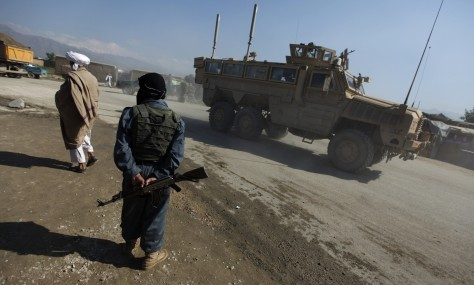 Image: A U.S. military vehicle enters the road leading to the U.S. airbase in Bagram