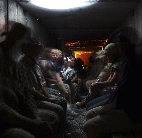 Image: ISAF personnel wait out attack