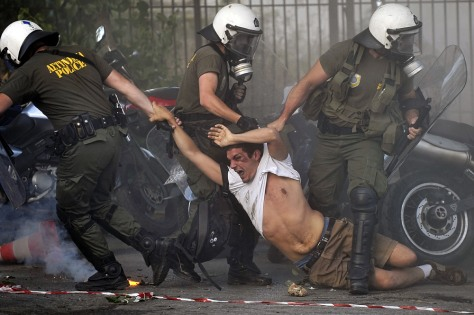 Image: Police drag a protestor during a pro-Palestine demonstration