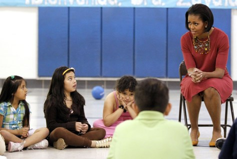 Image: Michelle Obama talks with students
