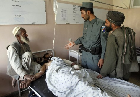 Image: Injured man at a hospital following a blast in Kandahar city