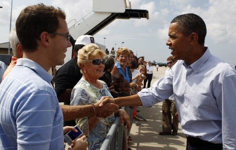 Image: U.S. President Barack Obama greets people after stepping off Air Force One at Gulfport Airport in Gulfport, Mississippi