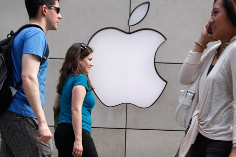 Image: Pedestrians walk past an Apple retail store in Chicago