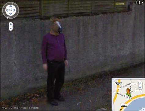 "Image: Google Street View of masked ""horse boy"""