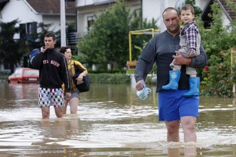Image: Residents in flooded town