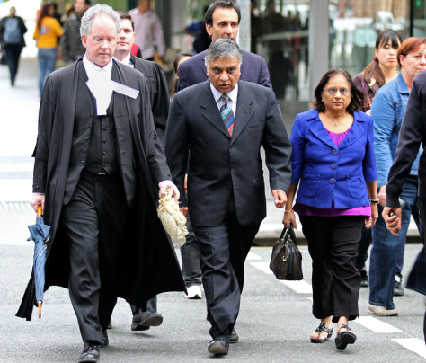 Image: Dr. Jayant Patel, center, arrives at the Supreme Court in Brisbane, Australia
