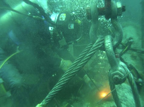 "Image: A diver works in preparation for ""re-abandonment"" of a subsea wellhead off the coast of California"