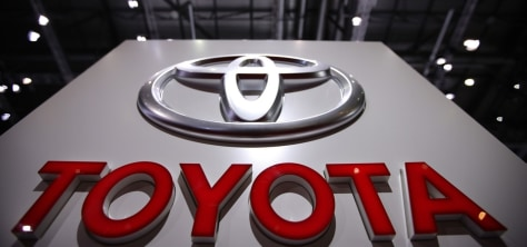 Image: File photo of the Toyota logo displayed during the 80th Geneva Car Show