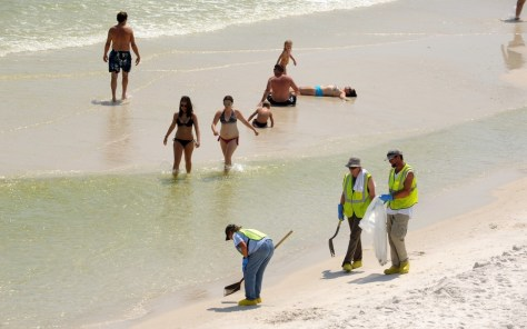 Image: Clean-up crews on Pensacola Beach