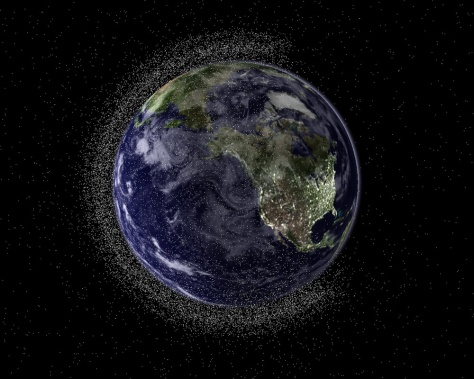 Image: Earth shown from space surrounded by debris