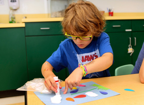 Image: A prekindergarten student works on an art project at the Walden Early Childhood Center