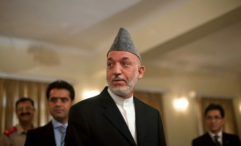 Image: Afghan President Karzai after a news conference in Kabul