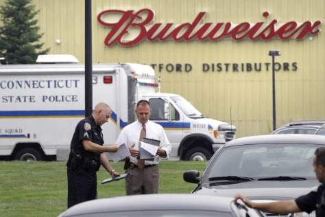 Image: Police work at the scene of a shooting in Connecticut