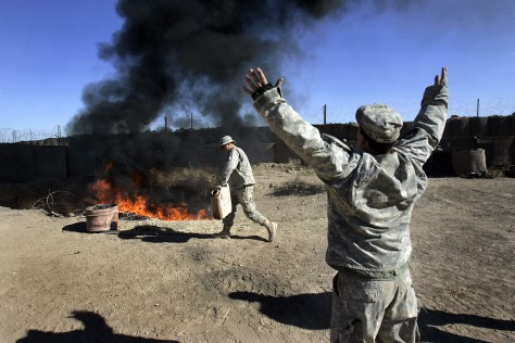 Image: U.S. soldiers burning garbage in Iraq