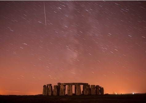 Image: A meteor streaks past stars in the night sky over Stonehenge.
