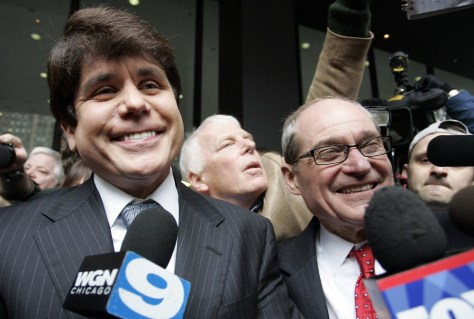 Image: Blagojevich smiling as he and his attorney leave federal court in Chicago