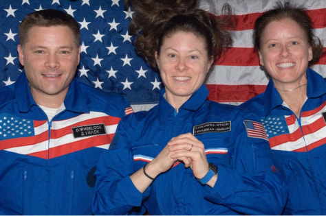 Image: American astronauts Doug Wheelock, Tracy Caldwell Dyson and Shannon Walker