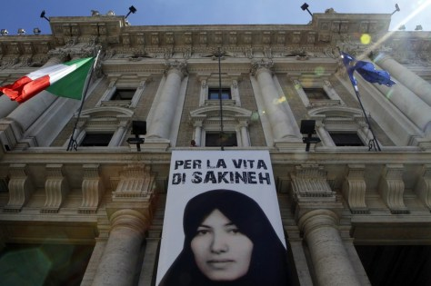 Image: A banner in support of Sakineh Mohammadi Ashtiani is hung outside the Equal Opportunities Ministry palace in Rome