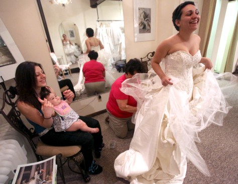 Image: Jessica Vega being fitted for her donated wedding gown