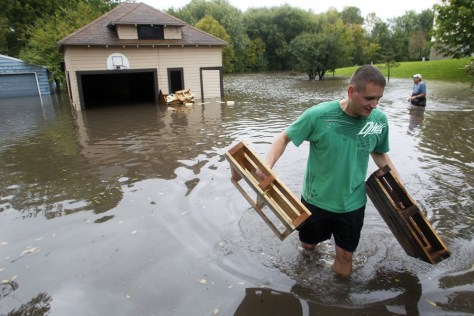 Image: Residents remove items from flooded homes