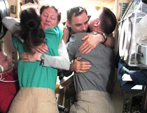 Image: Farewell hugs