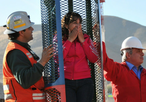 Image: Miner's daughter Carolina Lobos checks rescue capsule
