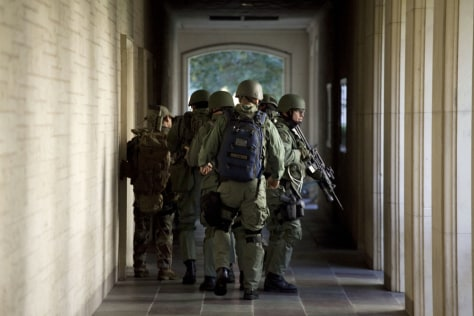 Image: Soldiers prepare to enter Calhoun Hall at the University of Texas in Austin.
