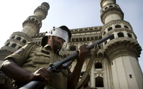 Image: An Indian policeman stands guard in front of the landmark Charminar in Hyderabad, India.