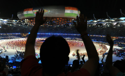 Image: Spectators cheer during the XIX Commonwealth Games opening ceremony