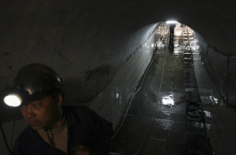 Image: A rescuer is seen in a tunnel of the Pingyu No.4 Coal mine in Yuzhou