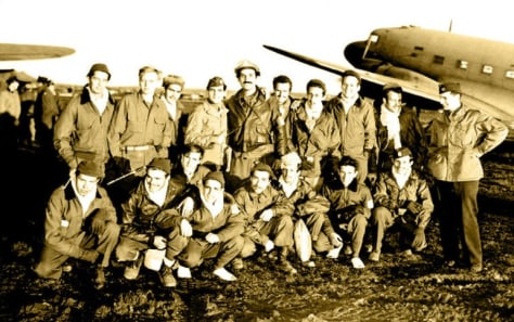 Image: OSS Capt. George Vujnovich, right, stands in Bari, Italy with a group of Allied airmen he helped rescue