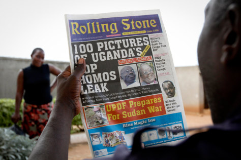 "Image: A Ugandan man reads the headline of the Ugandan newspaper ""Rolling Stone"" in Kampala, Uganda"