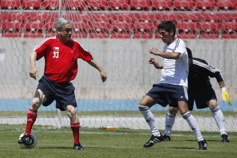 Image: Chile's president plays soccer with miners