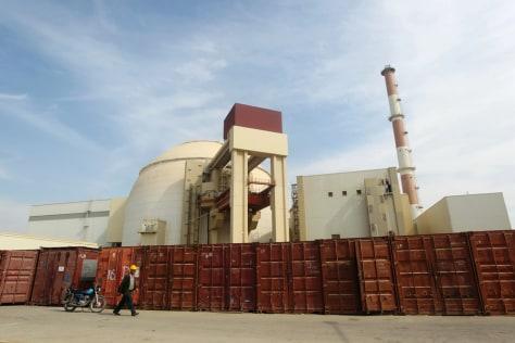 Image: Russian worker walks past Bushehr nuclear power plant, 1,200 km south of Tehran