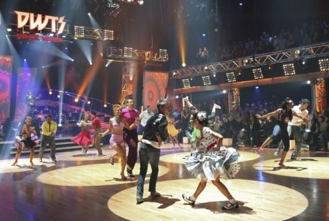 "Image: ""Dancing"" contestants compete in a group performance"