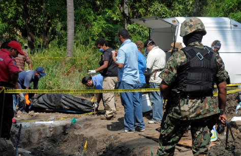 Image: Forensic workers in Tuncingo, Mexico