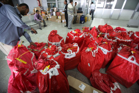 Image: A DHL worker checks parcels at Sanaa International Airport