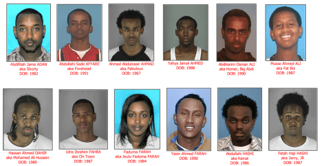Image: 12 of the 29 people that have been indicted and taken into custody in a sex trafficking ring in which Somali gangs in Minneapolis and St. Paul