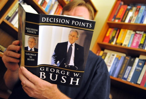 "Image: A man reads ""Decision Points,"" the new memoir by former President George W. Bush."