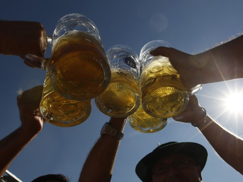 Image: People toast with beer mugs at Munich's Oktoberfest