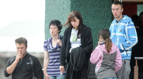 Image: Relatives of one of the 29 miners and contractors trapped in the Pike River Mine leave a meeting in Greymouth