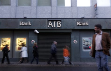 Image: People walk past a branch of the AIB bank on Merrion Row in Central Dublin