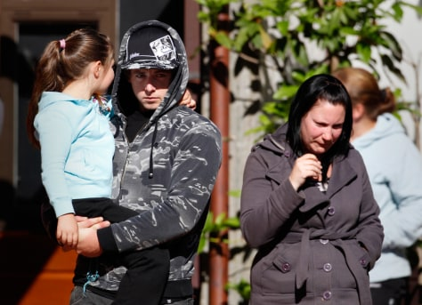 Image: Family members of miners trapped underground in the Pike River coal mine leave a briefing